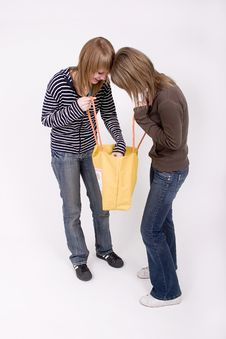 Free Teen Girls With A Yellow Bag Royalty Free Stock Photography - 2394277