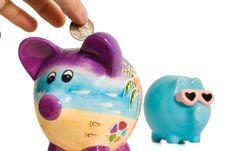 Free Quarter Into Piggy Bank Royalty Free Stock Photos - 2397118