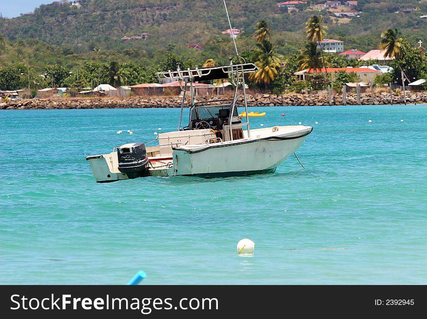 Fishing boat in caribbean bay