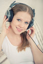 Free Woman Enjoys Listening To Music On Headphones Royalty Free Stock Photo - 23903905