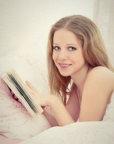 Young Beautiful Blonde Woman Reading Book