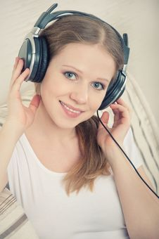 Woman Enjoys Listening To Music On Headphones Royalty Free Stock Photo