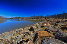Mountain Lake, Old Rocks And Deep Blue Sky Royalty Free Stock Image