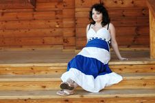 Free Woman On Wooden Porch Royalty Free Stock Photos - 23913538