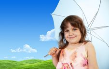 Baby Girl With Umbrella On Green Meadow Royalty Free Stock Images