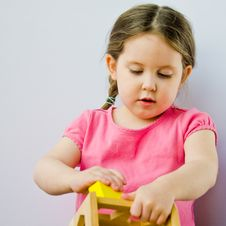 Free Little Girl Plays With Block Puzzle Royalty Free Stock Images - 23924959
