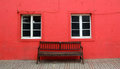 Free Bench And Two Windows On Red Wall Royalty Free Stock Photo - 23931115