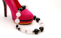 Free Necklace On Pink Female Shoe Stock Image - 23931771