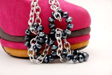 Free Black Earings On Pink Shoe Stock Images - 23931764
