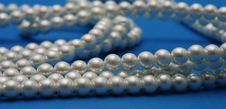 Free Pearls Necklace On Blue Royalty Free Stock Photos - 23931978