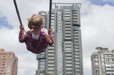 Free Little Girl Swinging In The City Royalty Free Stock Photography - 23934737