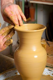 Free Craftsman Making Vase From Fresh Wet Clay Royalty Free Stock Photos - 23935088