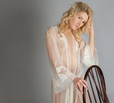 Blond Woman In Sheer Dressing Gown Stock Photography