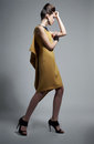 Free Fashionable Emotional Woman In Modern Yellow Dress Stock Photo - 23946780