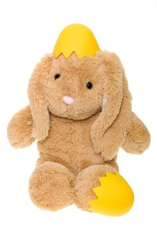 Free Stuffed Bunny Hatching From Yellow Egg Royalty Free Stock Photos - 23953338