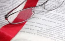Book Reading Glasses And Red Bookmark Stock Image