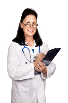 Female Mature Doctor Smiling Holding Clipboard Stock Images