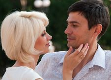 Beautiful Couple, A Woman Stroking Man S Cheek. Royalty Free Stock Images