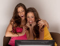 Free Gemini Sisters Watching A Horror Movie On TV Royalty Free Stock Photos - 23989908