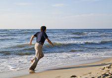 Free Man Running Along Seashore Royalty Free Stock Photography - 23988567