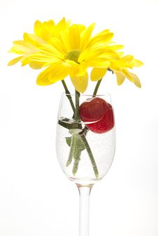 Free A Glass, Cherry And Yellow Flowers On A White Back Stock Image - 23988791