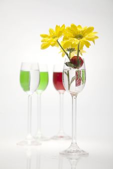 Free A Glass, Cherry And Yellow Flowers On A White Back Royalty Free Stock Photo - 23988875