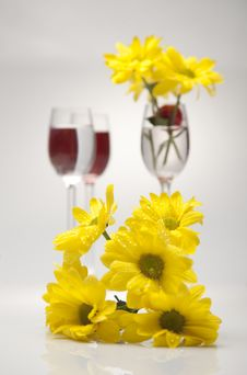 Free A Glass, Cherry And Yellow Flowers On A White Back Royalty Free Stock Images - 23988899