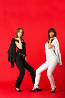 Free Pretty Sisters Twins In White And Black Costumes Stock Photo - 23995890