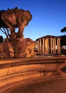 Free Triton Fountain And Temple Of Ercole Vincitore Royalty Free Stock Photography - 23996277