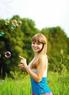 Free Happy Woman Playing With Soap Bubbles Stock Photo - 23998510