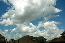 Free Clouds Over Houses Royalty Free Stock Photography - 245117
