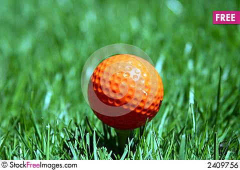 Free An Orange Golf Ball Royalty Free Stock Image - 2409756