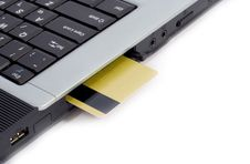 Free Credit Card Inserted In Laptop Stock Photos - 2400943