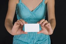 Free Girl Holding A Business Card Royalty Free Stock Photos - 2405498