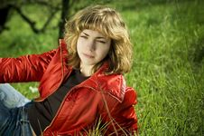 Free Blond Sitting On A Green Grass Stock Photos - 2405743