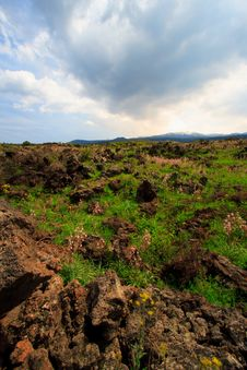 Sun, Clouds,and Old Lava Royalty Free Stock Photos