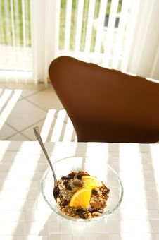 Free Healthy Muesli With Orange In The Morning Sun Royalty Free Stock Photography - 24006737