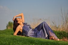 Free Beautiful Girl Laying On A Grass Royalty Free Stock Image - 24007526