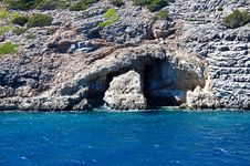 Grotto In The Rocky Slope. Stock Image
