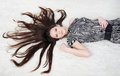 Free Beautiful Girl With Long Hair Lies On White Fur Royalty Free Stock Photography - 24019777