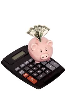 Free Calculator With Piggy Bank And Money Royalty Free Stock Photography - 24010997