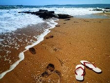 Sea Surf With Footprint Over Sand Royalty Free Stock Images