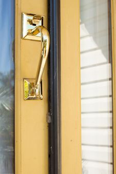Free Gold Lock And Handle Door On Yellow Royalty Free Stock Image - 24017316