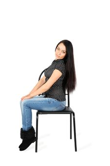 Free Beautiful Girl Wearing Jeans Sits On Chair Royalty Free Stock Photography - 24019617