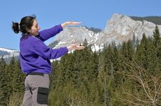 Free Woman Playing In The Mountains In Early Spring Stock Photos - 24019643