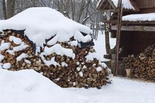 Heap Of Wood Near Old Cottage Royalty Free Stock Images