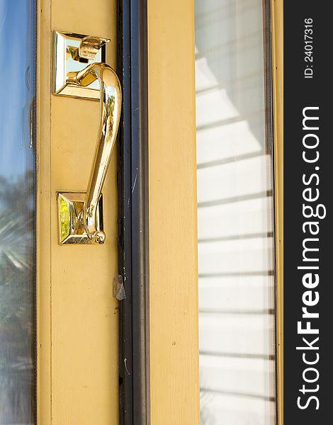 Gold lock and handle door on yellow