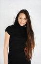 Free Brunette Girl Wearing Black Dress Looks At Camera Stock Photos - 24020313