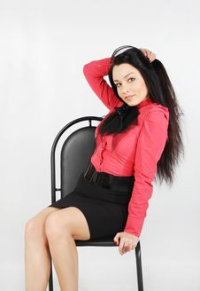 Free Girl Sits On Chair And Touches Her Hair Royalty Free Stock Photo - 24020055