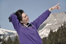 Young Woman At Winter In The Mountains Royalty Free Stock Photos